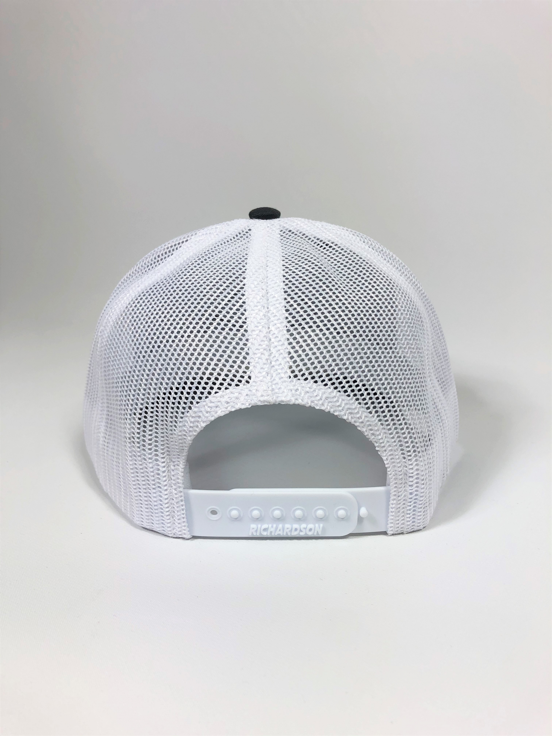 Back profile of charcoal and white trucker hat