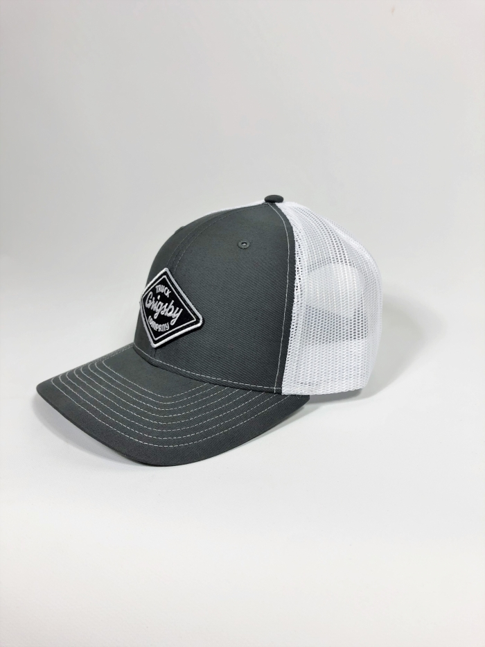 Side profile of charcoal and white trucker hat