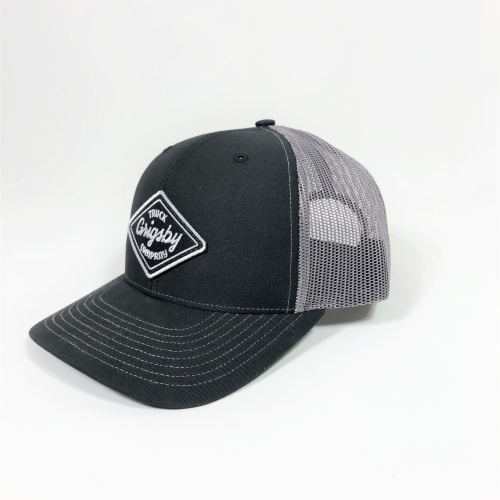 Side profile of charcoal and black trucker hat
